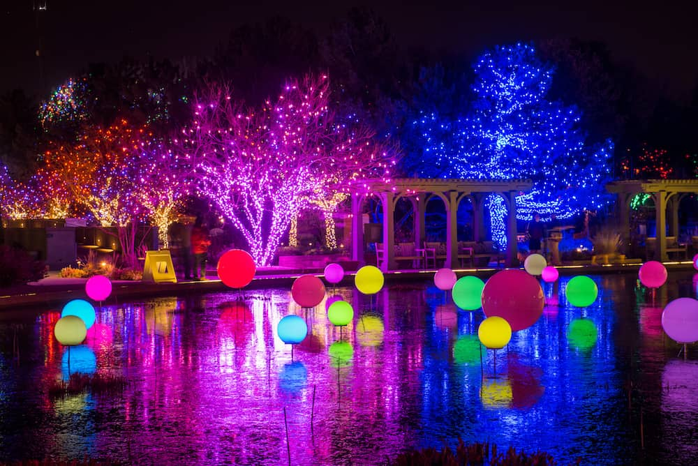 blossoms of light features a tunnel of twinkling lights the grand illuminated o fallon perennial walk changing color orbs and an extended pathway that